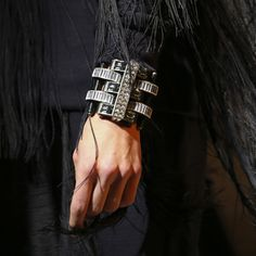 Statement cuffs at Lanvin - With clean, Art Deco lines, Elie Top's cuffs for Lanvin provided a point of contrast on wrists peeping out from the ostrich feathers and maribou trim, taking Alber Elbaz' 'Xtravagance' right down to the models' fingertips.
