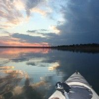 Boating on Lake Buchanan near the Painted Sky Inn  - a charming hidden Texas getaway on the eastern shore of Lake Buchanan in Burnet, Texas. Located on a quiet peninsula, all rooms  have a panoramic view of Lake Buchanan and the Central Texas Hill Country.ed Sky Inn