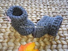 Soft Grey & Pink Flower handmade crochet baby boots are perfect for cool Fall days.    Please stop by my Etsy shop at www.etsy.com/shop/sweetheartsandsoles for more baby booties, as well as baby and toddler shoes and accessories!