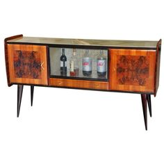 View this item and discover similar for sale at - Sleek Italian long bar cabinet / sideboard in manner of Ico Parisi with 2 doors, 1 drawer and dry bar with sliding etched glass doors. 1950s Furniture, Mid Century Modern Furniture, Furniture Styles, Bar Furniture, Sideboard Cabinet, Vintage Storage, Decorating Small Spaces, Room Decor, Interior