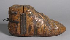 """Shoe Reliquary  Date: ca. 1350–1400 Culture: French or Swiss Medium: Leather and Iron Dimensions: H: 5 1/4"""" W: 11 1/4"""" D: 4 5/8"""" (13.3 x 28.6 x 11.7cm)"""