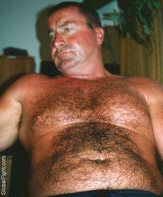 mechanic man resting taking off shirt
