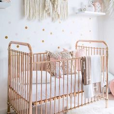 "Add a little luxe to your little one's bedroom. This gorgeous Ellie crib is finished in a our signature rose gold colour, featuring stationary side rails and two mattress heights. It has been expertly crafted of sturdy and strong metal with simple curves. Dimensions: 31"" W x 55"" L x 44"" H Fixed side rails: 40"" H Meets Australian and New Zealand, US and Canada safety standards."