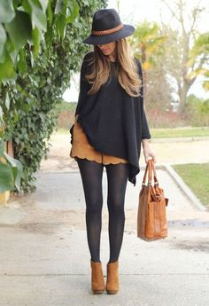 This beautiful ensemble of a poncho, shorts nod stockings make a cute little fall number. Always go for fall inspired colors such as brown and pair it up with another neutral color which is black. Don't forget to accessorize.