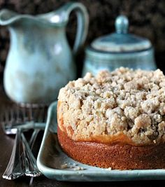 Amaretto Cream Cheese Coffee Cake Recipe- easy cake to make, great for holidays/ potlucks. A creamy layer and crunchy streusel crumb topping make it unique.