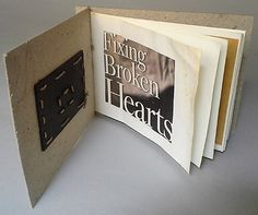 """Fixing Broken Hearts"", humble, recycled materials...repurposed cardboard, hemp cord, recycled paper, collage,  Side Stab Binding"