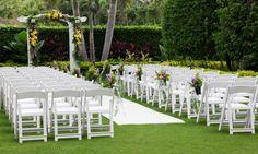 Colorful purple, yellow, green garden wedding ceremony area.