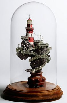 Japanese artist Takanori Aiba creates astoundingly detailed sculptures of tiny buildings. The sculptures are inspired by the Japanese art forms of bonsai (miniature trees) and suiseki (stone appreciation)