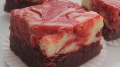 Moist, lightly chocolately red velvet brownies have a delectable swirl of cream cheese filling inside.