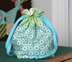 Tutorial on how to make a drawstring bag. I made a few of these in Christmas fabric... love them