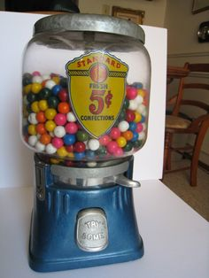 """Vintage Gum Ball Machine"" ~ Remember the neat charms they mixed in with the gum balls? One time I put my money in gave it a crank & the whole machine emptied! They gave me a brown paper bag to hold or all.....:)"