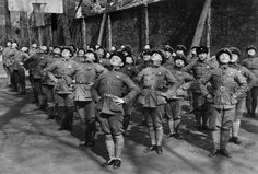 Robert Capa: CHINA. 1938. Hankow. Young women being trained as Nationalist Chinese soldiers.