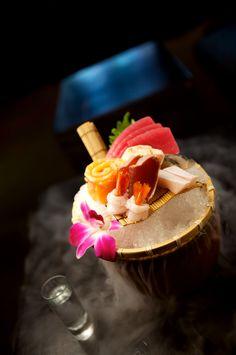 Sashimi Combination: assorted sashimi with maguro, sake, hamachi, shime saba, katsuo tataki, ama ebi & crispy ama ebi head over a bed of dry ice