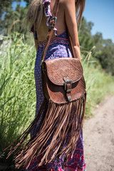 Make a statement with this incredible hand tooled over the shoulder leather bag - this psychedelic daydream is functional yet has some seriously sweet details in the tooling, leather weaving, dramatic tassels and buckles. This is one bag you won't want to take off!   Measurement Delivery & Returns   Width - 26cm Length - 26cm Strap Length (adjustable) - 104cm Tassel Length - 38cm   FREEåÊWORLDWIDE SHIPPING We want you to be completely satisfied with your online purchase. If you are unhapp...