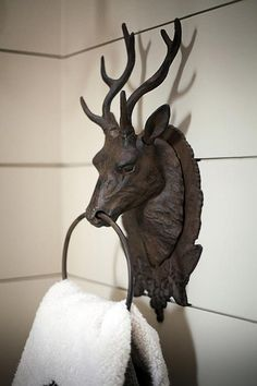 .use a door knocker as a hand towel holder or in the kitchen for dish towels