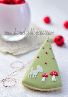 Tree Cookies:  iced shortbread in pale green with red mushrooms, critter and red ornaments