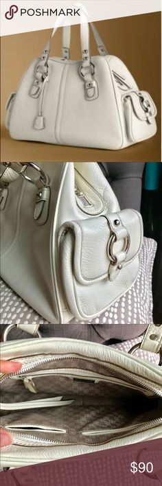 """Banana Republic Bedford Satchel Handbag Chic, polished and timeless, commanding attention in any outfit yet blending as seamlessly into a work ensemble as into your weekend wardrobe. We love the luxurious leather and brass hardware, plus the extra pockets and organizational features. Get it in """"Vanilla ,"""" a warm cream color, or in """"Mocha,"""" a rich chocolate brown. This is an investment piece that will serve you for years. Never been used comes with original care tags, dust cover, wrapped BR…"""