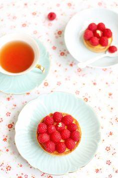 laduree's passionfruit raspberry tart  via evan's kitchen ramblings.