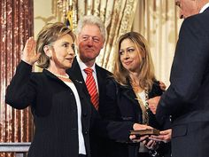 Party of Three:  Hillary Rodham Clinton (being sworn in as Secretary of State under President Obama); former President  Bill Clinton, and their daughter, Chelsea Clinton.