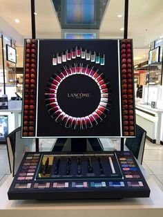 This Lancôme display does a great job touching upon geometry with the grid border of the different shades of lipstick and eye shadows and circular composition of nail polish and mascara with a white light backlight that draws attention to the rhythm of the repeating elements and powerful vibrant, show stopping theme. The contrast of the black with the bright, exciting colors drew my eye to the display and stopped me as I walked through the store to see what merchandise was being offered.