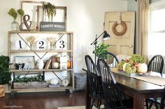 Pumpkins scattered throughout this dining room give a subtle nod to fall without going overboard.