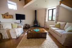 Relax in the Old Shippon's cosy sitting room after a day exploring North Devon Devon Holidays, Pet Friendly Holidays, Luxury Holiday Cottages, Farm Cottage, Stone Barns, North Devon, Dog Friends, Cosy, Exploring
