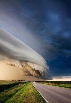 Awesome Arcus Storm Cloud in Nebraska by Ryan McGinnis. Photo, clouds, road, field view, breathtaking, stunning.