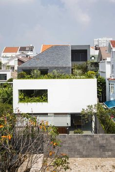 Completed in 2016 in Ho Chi Minh City, Vietnam. Images by Hiroyuki Oki. This house is located in a residential area in District 7 of Ho Chi Minh city and hosts a couple with 2 young kids. The land is a square of Design Exterior, Facade Design, House Design, Green Architecture, Residential Architecture, Architecture Design, Modern House Facades, Box Houses, House Elevation
