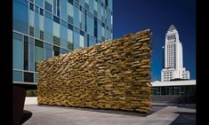 Los Angeles Memorial to Fallen Police Officers: Over 12 ft. high by 32 ft. long and 11,000 pounds, the porous brass wall scatters the Los Angeles light against its many metal surfaces.