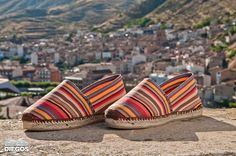 babf3f54d963b5 Traditionally handcrafted flat espadrilles, enjoy the warm look of these  striped espadrilles with vibrant colors adding a joyful touch to your look.