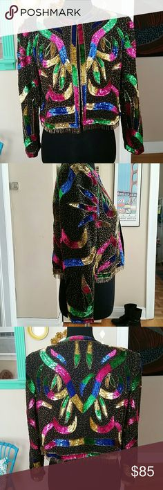 VTG Retro Bright Beaded/Sequins Scala Jacket! S/M Holy smokes this is the most amazing jacket I've ever found! Incredible condition with no known/seen flaws. Looks like it's honestly never been worn! 100% silk lining & 100% polyestor. Tag says Scala PM (petite med). Definitely a S/M. Has one small clasp at top to close and the rest of the jacket is open for that hugging look. Has fringe at bottom of jacket that are beaded. Hot pink, green, gold, black, blue! Very retro! Shoulder pads sewn in…