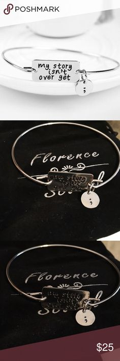 """My Story Isn't Over Yet"" Silver Plated ; Bangle Gold plated bangle. Brand new in package. Such a meaningful symbol for an amazing cause. Details from website in pictures 1 and 4. Diameter 7cm. ❌ NO TRADES ❌ NO LOWBALLING ❌ Florence Scovel Jewelry Bracelets"