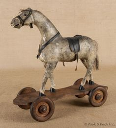 Athco composition horse pull toy, early 20th c.   Repinned from High Button Shoe, Tidajune.  What a great use for an old skate.