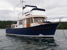 Our 34 foot tri-cabin CHB trawler, Heron.