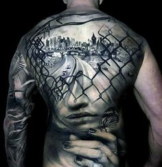Full Back City Skyline With Chain Fence And Female Portrait Great Tattoo Design On Man