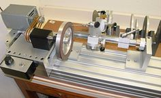 Cutter Grinder Sharpener by Swede -- Homemade cutter grinder sharpener constructed from aluminum stock, aluminum extrusions, pulleys, electric motor, and a switch. http://www.homemadetools.net/homemade-cutter-grinder-sharpener