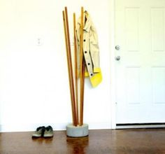 DIY Industrial Concrete And Broomstick Coat Tree | Shelterness