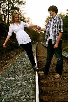 how cute. couple on train tracks.