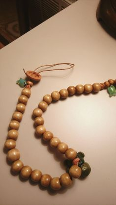 For all lovers of sea life, this necklace features glass fish beads and a terra cotta clay turtle pendant.