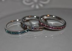 Stackable Eternity Band (Birthstones)-I want one with ruby (David's birthday in July) and two for the girls with either Zircon or Turquoise (both for the girls birthdays in December)
