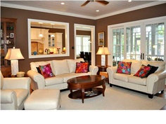 A comfortable living room kept spacious with a peek-a-boo kitchen window and deck doors #CharlestonScRealEstate
