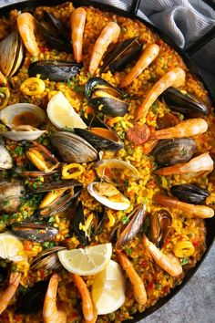 The most beloved of all Spanish dishes, Paella is an impressive combination of saffron-infused short-grain rice mixed with meat, seafood, and vegetables. Filled with traditional Spanish flavors, learn everything you need to know about making this delicious, crowd-pleasing Spanish paella recipe. Seafood Recipes, Dinner Recipes, Cooking Recipes, Seafood Paella Recipe, Spanish Seafood Paella, Spanish Dishes, Spanish Cuisine, Spanish Recipes, Gastronomia