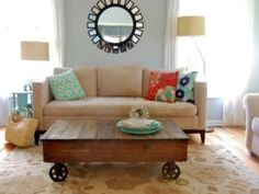 Coffee table by Chucks Angel... I like the big round wheels... Maybe replace the smaller castors for fun?