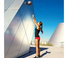 Works: shoulders, chest, arms, back, abs, butt, thighs Start with Wall Ball. Stand with feet hip-width apart, holding ball at chin with elbows at sides; squat until thighs are parallel to ground. Explode up, extending arms as you throw ball against wall (as shown). Catch ball and immediately return to start. Repeat for 45 seconds. Rest 15 seconds. Tank, $66; LornaJane.com. Shorts, Elisabetta Rogiani, $61; Rogiani.com. Watch, Seiko, $375; Macy's. Sneakers, Under Armour, $100; UA.com