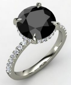 Carrie Bradshaw engagement ring- Sex & the City. Love the black diamond look :)