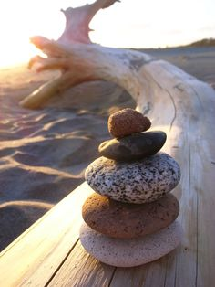 love making sculptures with pebbles on the beach