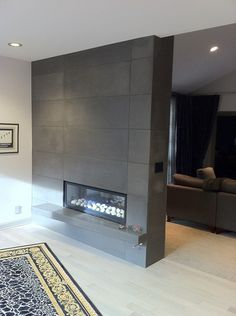 Spark gas fireplace and a concrete fireplace surround. Concrete ...