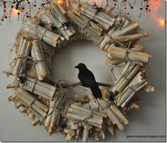 "Wreath made from pages of old books.  From blog post of ""10 Things to buy from Thrift and Fabric Stores for Halloween""  #HalloweenWreath"