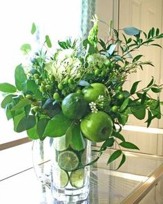 With most of its materials sourced from the grocery store, this unique, punchy arrangement is not only super fresh, but is also a great low-cost alternative to a traditional fresh flower bouquet. Make your own from an assortment of Granny Smith apples, limes, ornamental kale, green hypericum, Bells of Ireland, Italian ruscus, Silver Dollar eucalyptus and lemon leaf greenery.