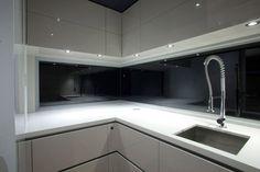 Down lights in overhead cupboards http://www.design-decor-staging.com/blog/wp-content/uploads/2012/01/modern-kitchen-design-ideas-6.jpg